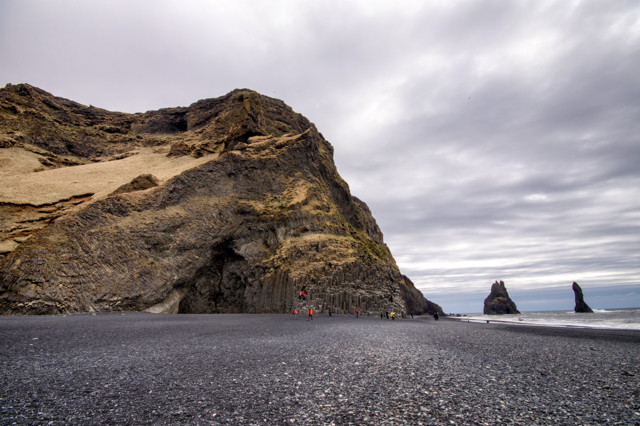 The basalt cliffs at Reynisfjara. Reynisdrangar is on the right.