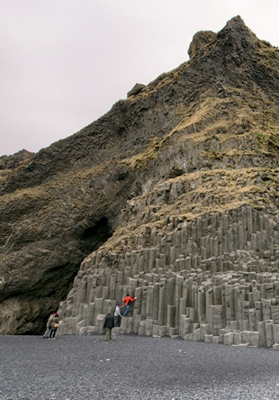 People climbing the cliffs at Reynisfjara