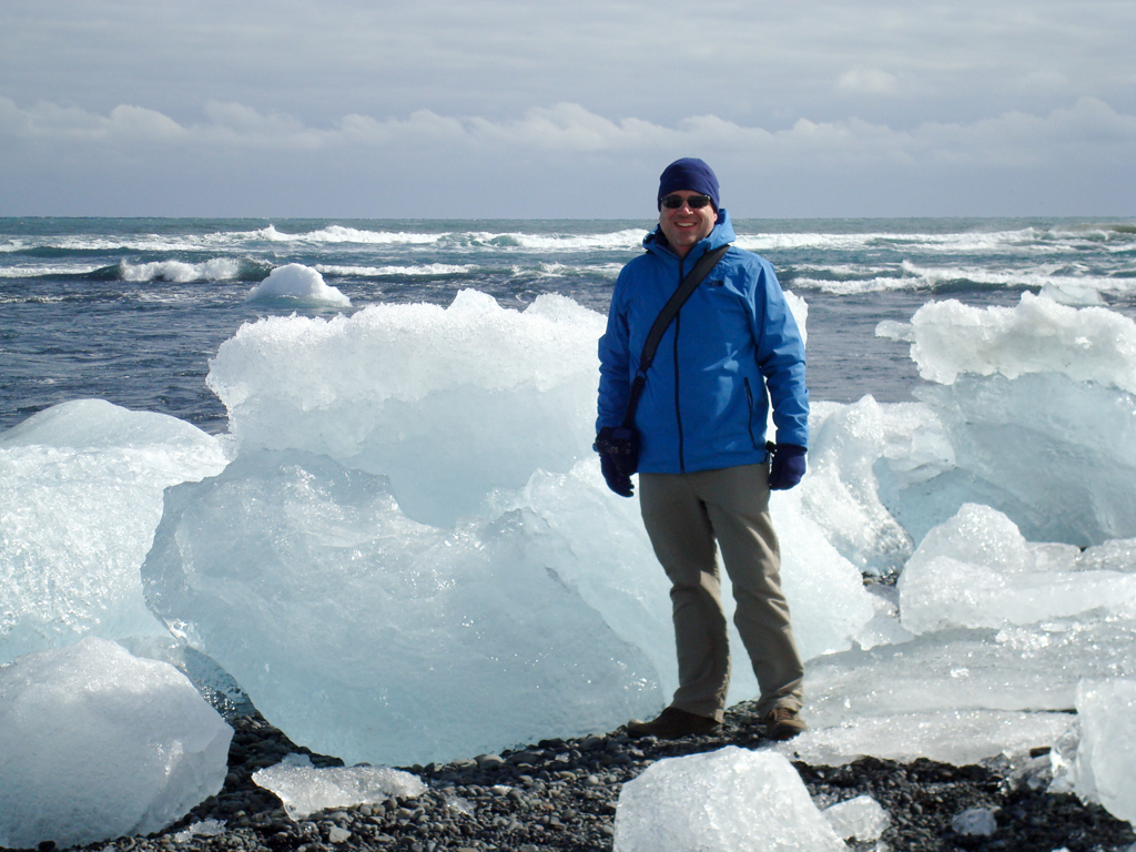 Standing next to an iceberg