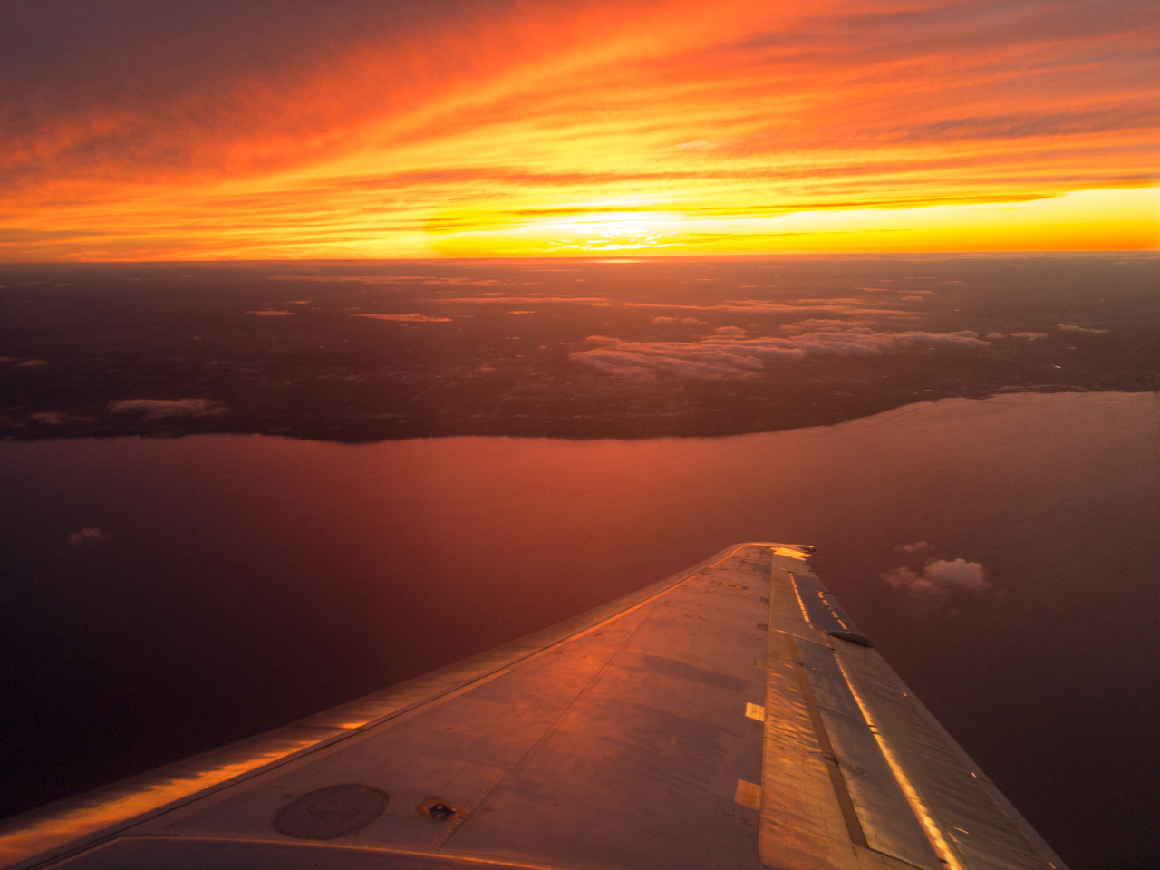 Sunset over Lake Michigan as seen from an airplane